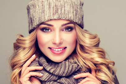 Attractive blonde haired model dressed in stylish knitted winter clothes