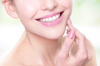 Attractive smiling woman face with health teeth