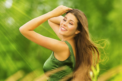 Beautiful Active Free Girl on Summer Green Outdoor Background