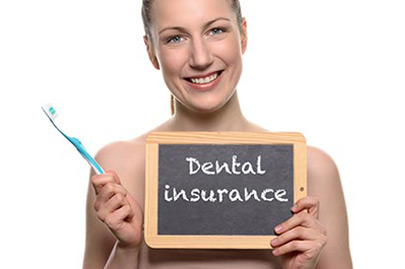 Beautiful woman holding dental insurance sign