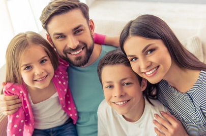 Beautiful young parents with daughter and son