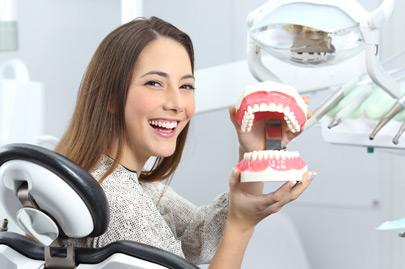 Dentist patient smiling with a plastic denture