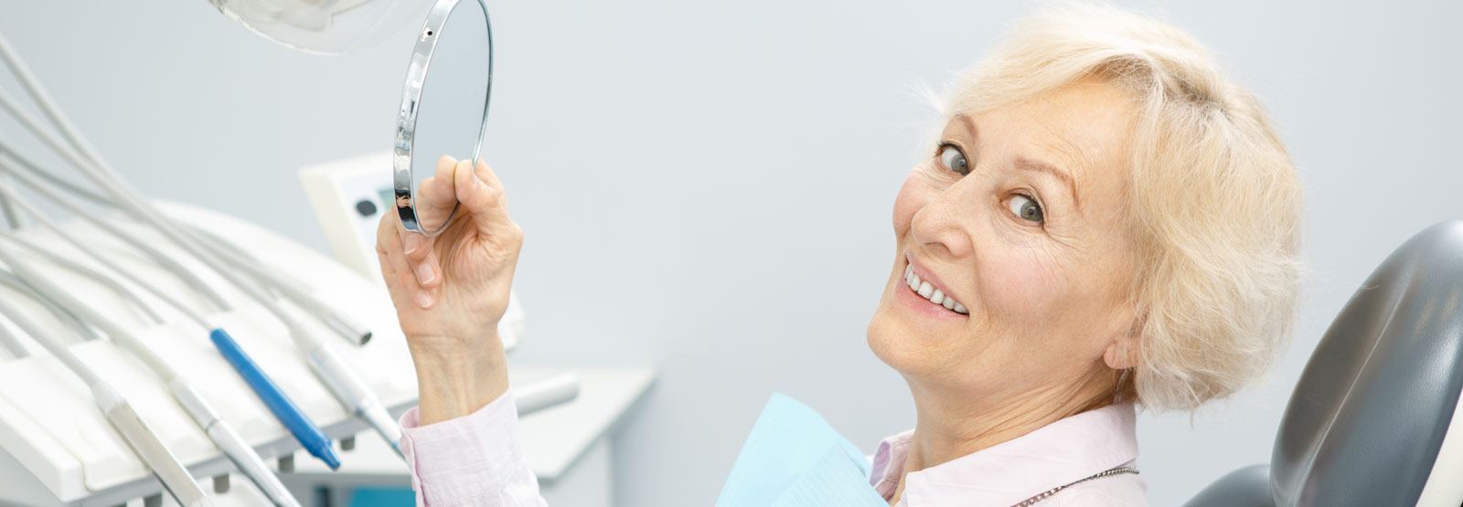 Elderly woman checking her dentures