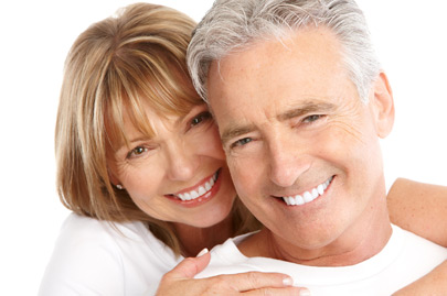 Elderly smiling couple on white background