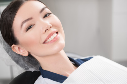 Outgoing patient smiling in dental office