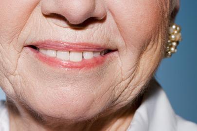 Senior woman wearing earrings