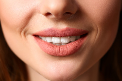 Smiling female closed red lips closeup