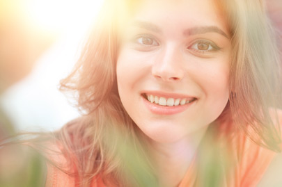 Smiling woman face on blurred background