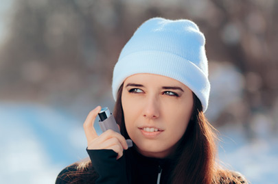 Woman with Inhaler Suffering Asthma Attack in Winter Asthmatic patient managing condition with medication in cold season
