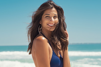Young woman smiling at sea